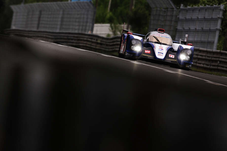 The Toyota Racing TS030 Hybrid of Alexander Wurz, Nicolas Lapierre and Kazuki Nakajima drives during the Le Mans 24 Hour race at the Circuit de la Sarthe on June 22, 2013 in Le Mans, France. Photo: Ker Robertson, Getty Images / 2013 Getty Images