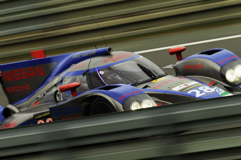The Gulf Racing Middle East car of Fabien Giroix, Keiko Ihara and Philippe Haezebrouck drives during the Le Mans 24 Hour race at the Circuit de la Sarthe on June 22, 2013 in Le Mans, France. Photo: Ker Robertson, Getty Images / 2013 Getty Images