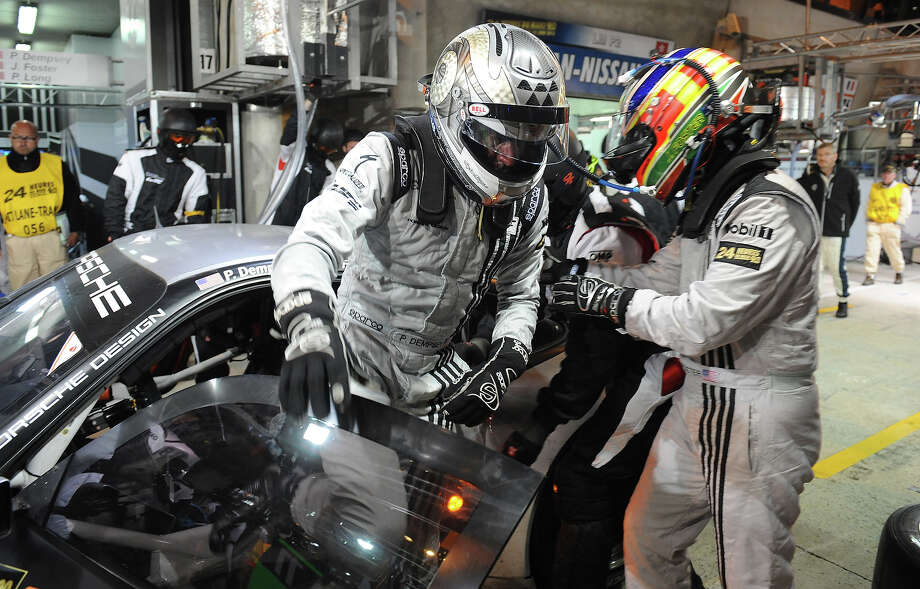 US actor Patrick Dempsey (L) out of his Porsche 911 N∞77 after a relay  with US Joe Foster (R) during the 90th 24-hours of Le Mans endurance race on June 23, 2013, in Le Mans, western France. Photo: JEAN FRANCOIS MONIER, AFP/Getty Images / 2013 AFP