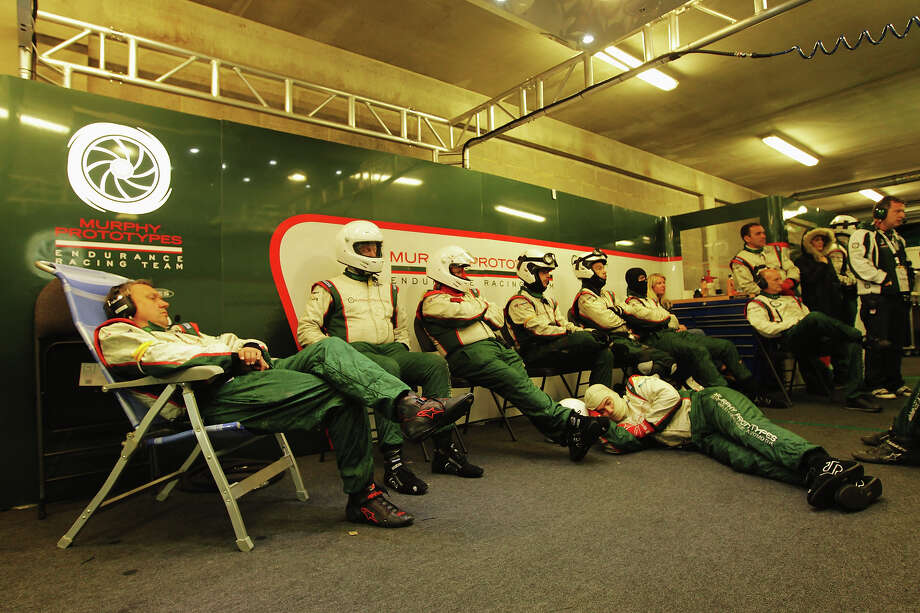 Mechanics rest in the Murphy Prototypes garage during the Le Mans 24 Hour race at the Circuit de la Sarthe on June 23, 2013 in Le Mans, France. Photo: Ker Robertson, Getty Images / 2013 Getty Images
