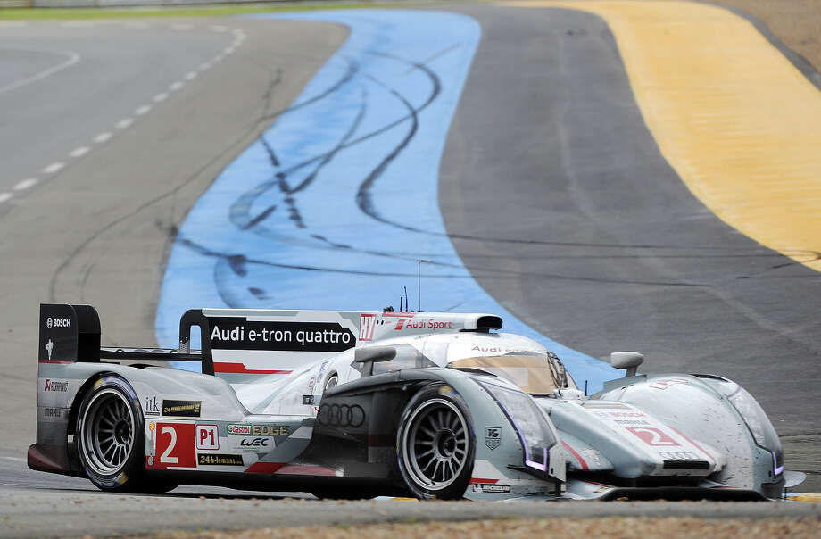 The Audi R18 e-tron quattro N∞2 driven by French driver Loic Duval takes a curve during the 90th 24-hours of Le Mans endurance race on June 23, 2013, in Le Mans, western France. Photo: JEAN FRANCOIS MONIER, AFP/Getty Images / 2013 AFP