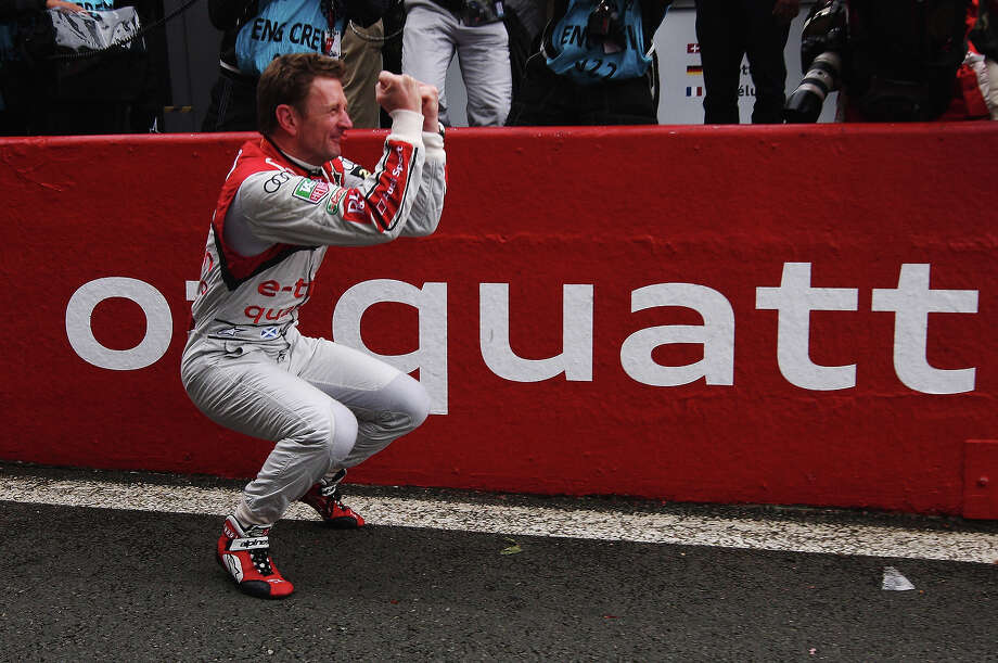 Allan McNish of Great Britain celebrates as he and his fellow Audi Sport Team e-tron quattro co-drivers Tom Kristensen of Denmark and Loic Duval of France win the Le Mans 24 Hour race at the Circuit de la Sarthe on June 23, 2013 in Le Mans, France. Photo: Ker Robertson, Getty Images / 2013 Getty Images