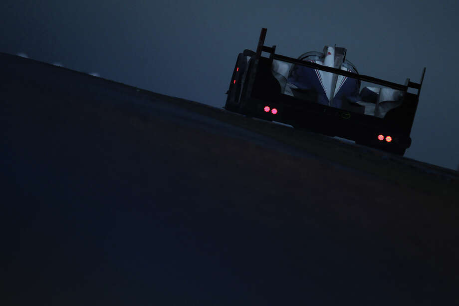 The second placed Toyota Racing TS030 Hybrid team of Stephane Sarrazin, Anthony Davidson and Sebastien Buemi drives at dawn during the Le Mans 24 Hour race at the Circuit de la Sarthe on June 23, 2013 in Le Mans, France. Photo: Ker Robertson, Getty Images / 2013 Getty Images