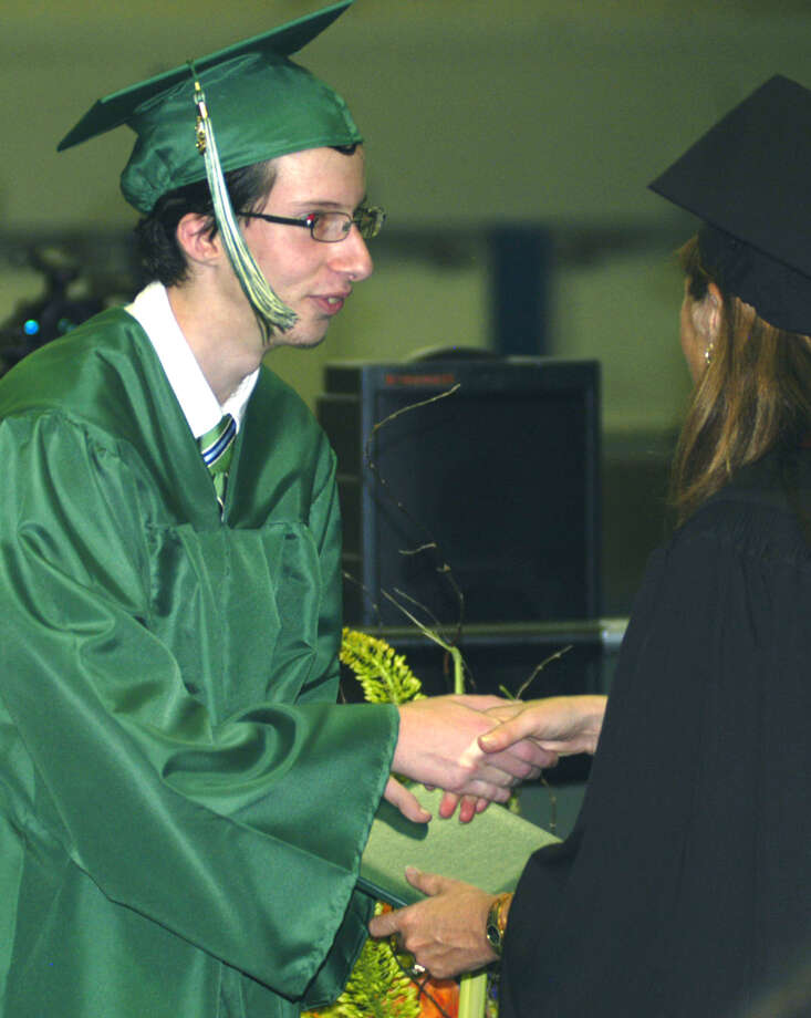 Nathaniel Crumlich receives his diploma from Board of Education chairwoman Wendy Faulenbach during New Milford High School's commencement exercises at the O'Neill Center on the campus of Western Connecticut State University in Danbury. June 22, 2013 Photo: Norm Cummings