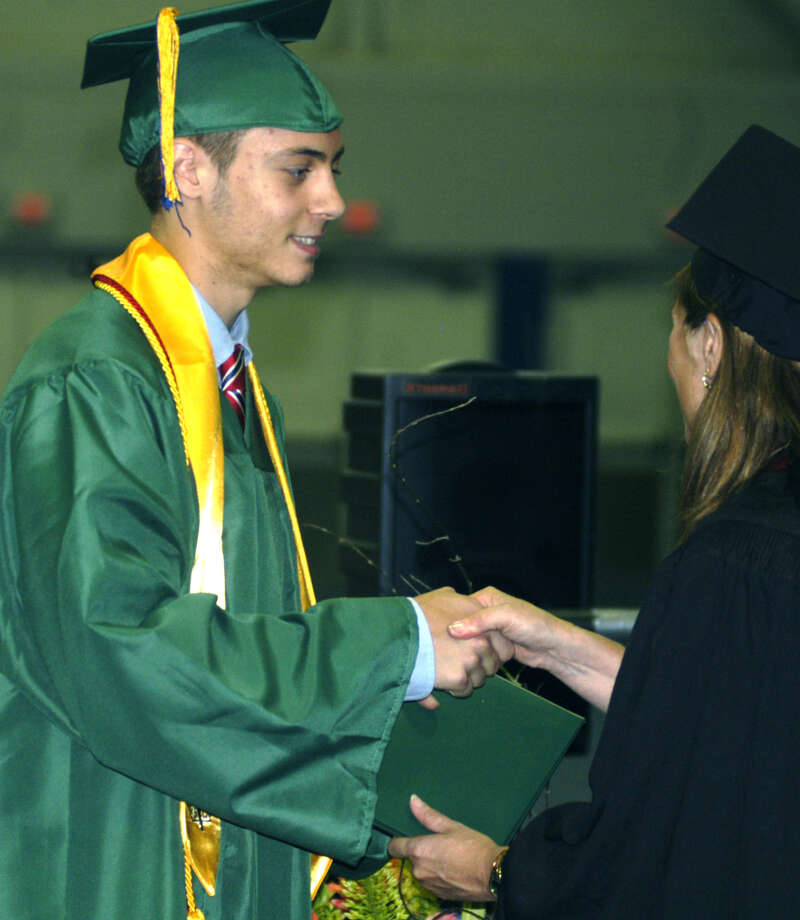 James Curley receives his diploma from Board of Education chairwoman Wendy Faulenbach during New Milford High School's commencement exercises at the O'Neill Center on the campus of Western Connecticut State University in Danbury. June 22, 2013 Photo: Norm Cummings