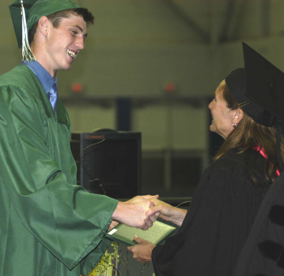 Drake Decker receives his diploma from Board of Education chairwoman Wendy Faulenbach during New Milford High School's commencement exercises at the O'Neill Center on the campus of Western Connecticut State University in Danbury. June 22, 2013 Photo: Norm Cummings