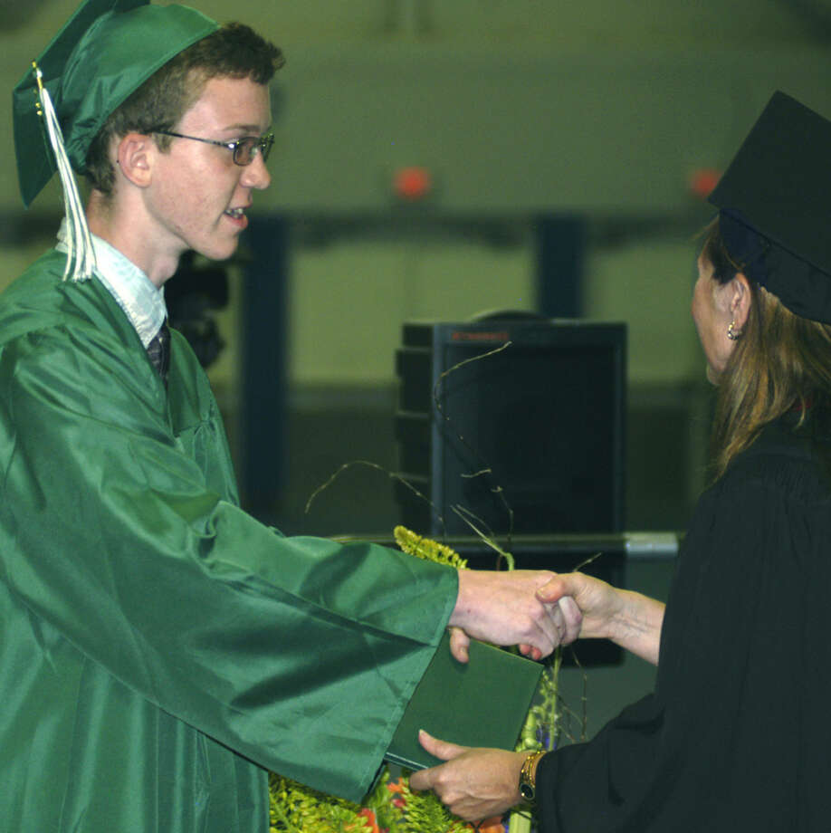 Matthew Dee receives his diploma from Board of Education chairwoman Wendy Faulenbach during New Milford High School's commencement exercises at the O'Neill Center on the campus of Western Connecticut State University in Danbury. June 22, 2013 Photo: Max Steinmetz