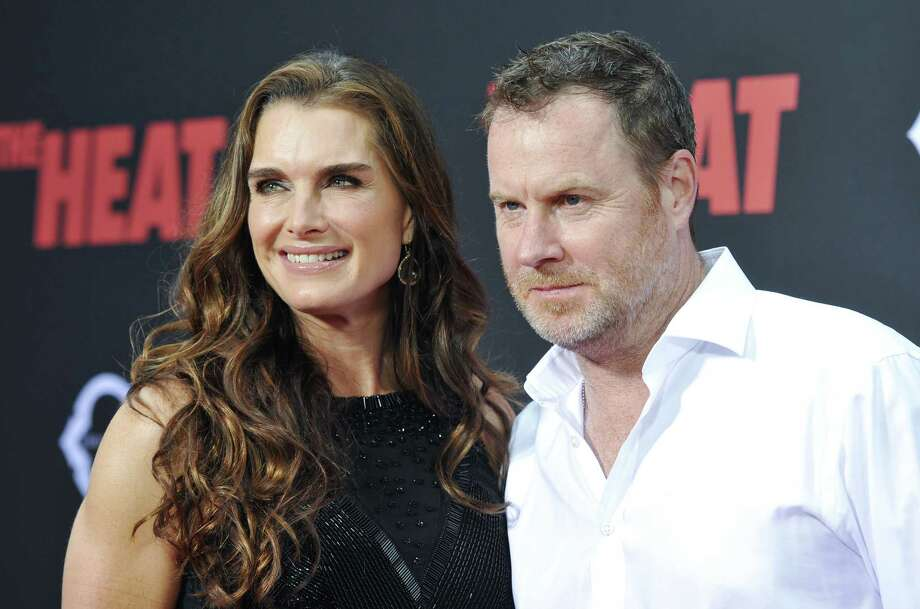 "Actress Brooke Shields and husband Chris Henchy attend ""The Heat"" premiere at the Ziegfeld Theatre on Sunday, June 23, 2013 in New York. Photo: Evan Agostini, Evan Agostini/Invision/AP / Invision"