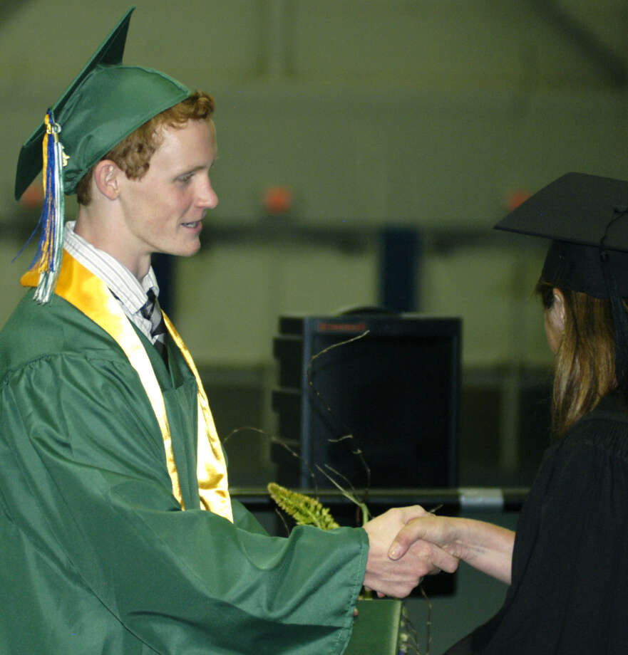 Spencer Devlin receives his diploma from Board of Education chairwoman Wendy Faulenbach during New Milford High School's commencement exercises at the O'Neill Center on the campus of Western Connecticut State University in Danbury. June 22, 2013 Photo: Norm Cummings