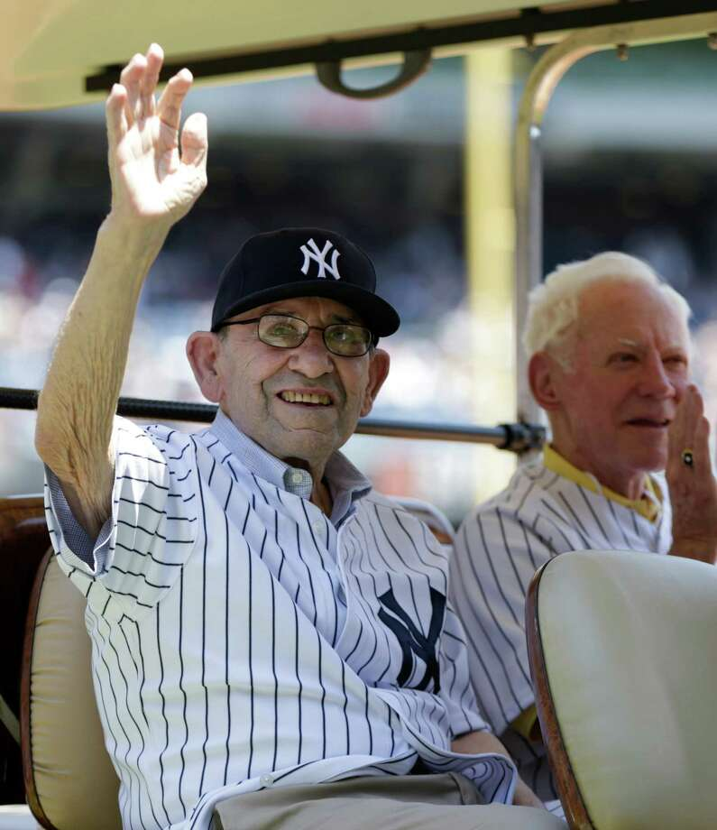 New York Yankees Hall of Famers Yogi Berra, left, and Whitey Ford sit in the shade of a golf cart as they are introduced before the Yankees Old Timers Day baseball game, Sunday, June 23, 2013, at Yankee Stadium in New York. Photo: Kathy Willens, AP / AP