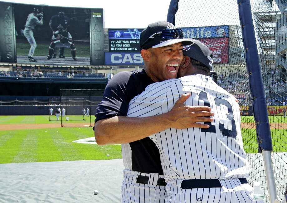 New York Yankees relief pitcher Mariano Rivera, left, embraces Charlie Hayes before the Old Timers Day baseball game at Yankee Stadium, Sunday, June 23, 2013, in New York. Photo: Kathy Willens, AP / AP