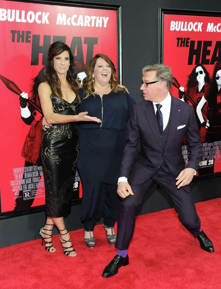 "Actors Sandra Bullock, left, and Melissa McCarthy and director Paul Feig attend ""The Heat"" premiere at the Ziegfeld Theatre on Sunday, June 23, 2013 in New York. Photo: Evan Agostini, Evan Agostini/Invision/AP / Invision"