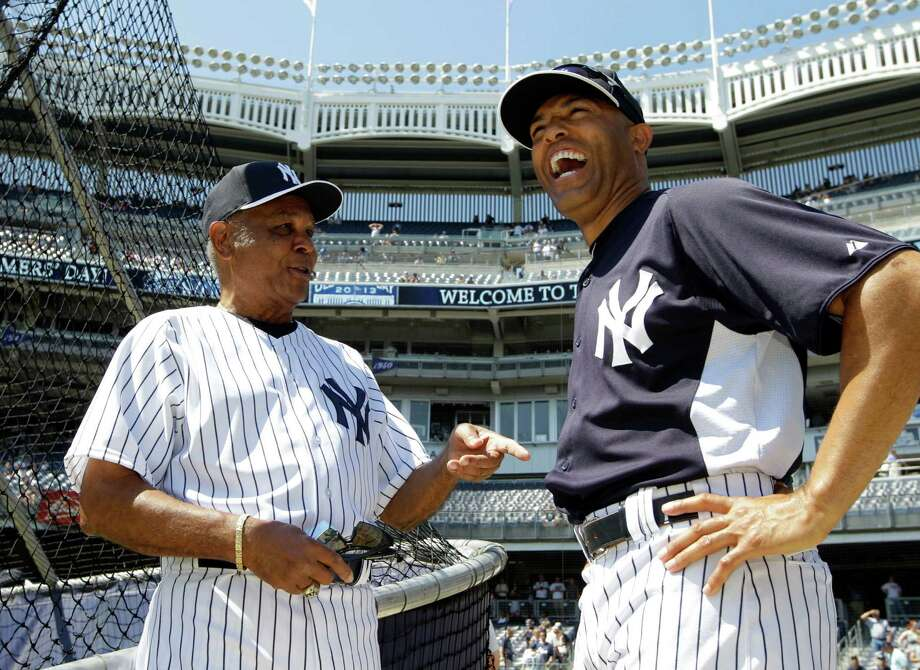 Former New York Yankees player Hector Lopez, left, and Yankees relief pitcher Mariano Rivera talk by the batting cage before the Old Timers Day baseball game on Sunday, June 23, 2013, in New York. Photo: Kathy Willens, AP / AP