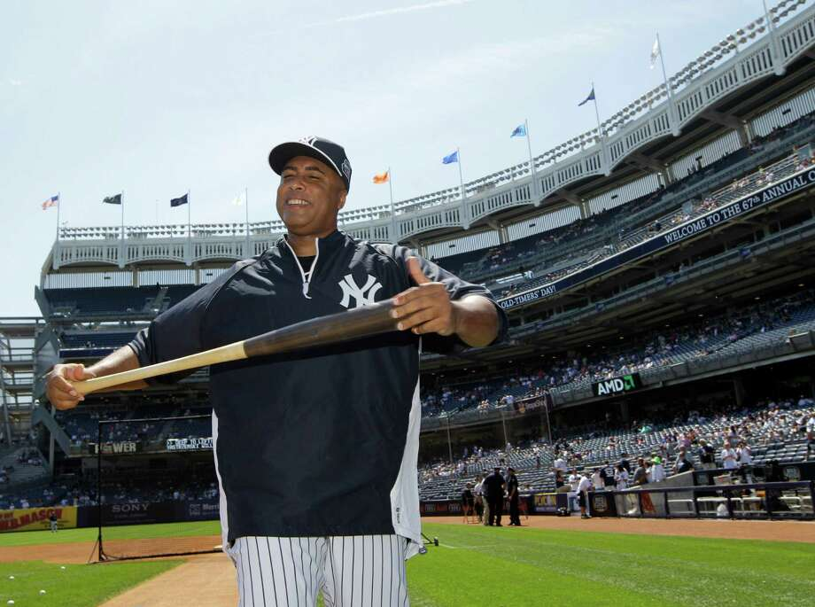 Former new York Yankees outfielder Bernie Williams stretches with a bat before the Old Timers Day baseball game on Sunday, June 23, 2013, in New York. Photo: Kathy Willens, AP / AP