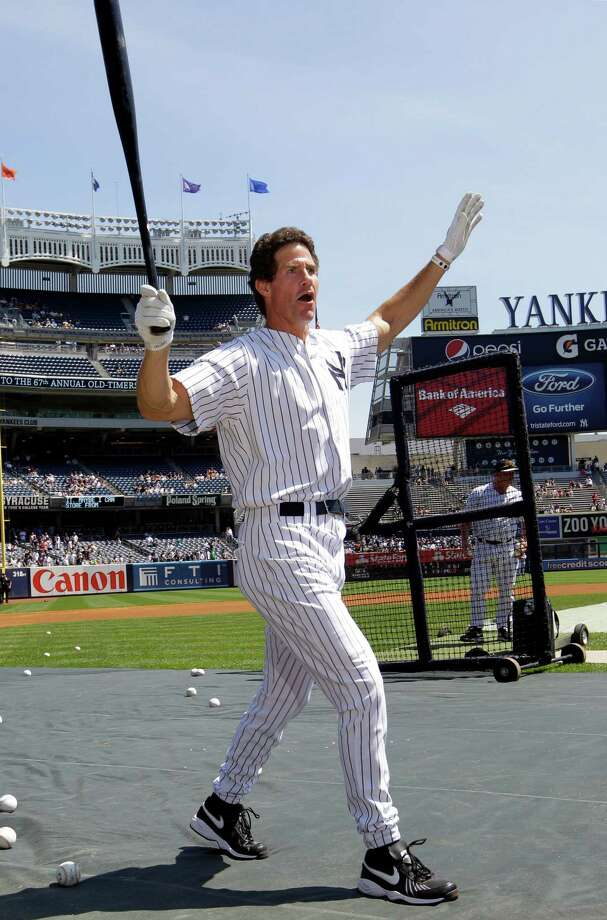Former New York Yankees outfielder Paul O'Neill reacts after hitting a home run in batting practice before the Old Timers Day baseball game Sunday, June 23, 2013, in New York. Photo: Kathy Willens, AP / AP