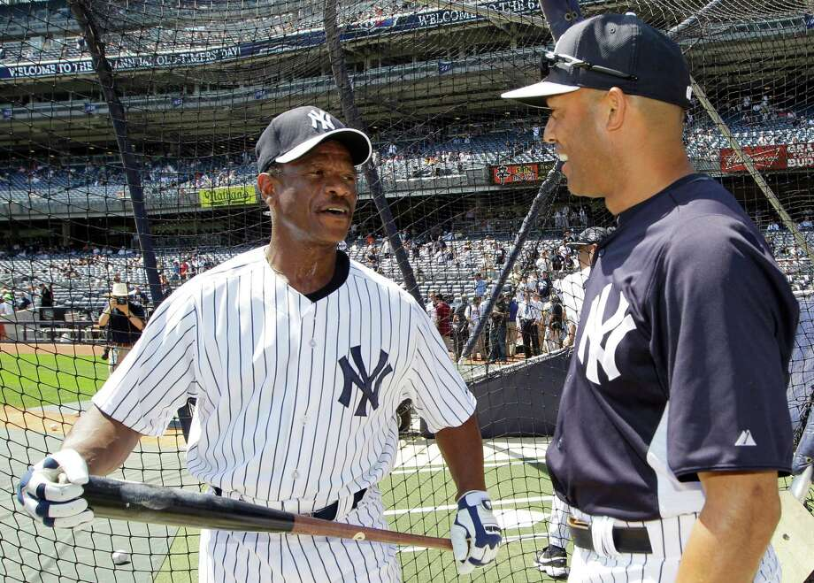 Former New York Yankees player Rickey Henderson, left, talks with Yankees relief pitcher Mariano Rivera before the Old Timers Day baseball game on Sunday, June 23, 2013, in New York. Photo: Kathy Willens, AP / AP