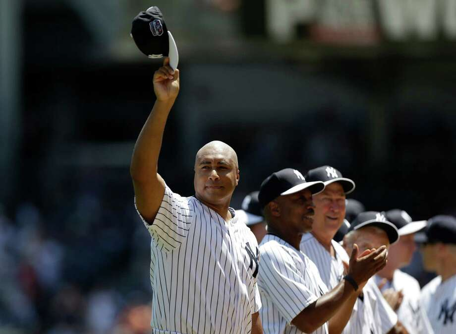 Former New York Yankees outfielder Bernie Williams waves his cap as he is introduced before the Yankees Old Timers Day baseball game on Sunday, June 23, 2013, at Yankee Stadium in New York. Photo: Kathy Willens, AP / AP