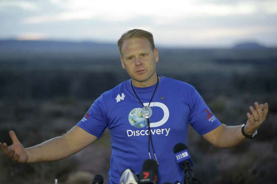 Daredevil Nik Wallenda smiles during a news conference after crossing a tightrope 1,500 feet above the Little Colorado River Gorge Sunday, June 23, 2013, on the Navajo reservation outside the boundaries of Grand Canyon National Park.  Wallenda completed the tightrope walk that took him a quarter mile across the gorge in just more than 22 minutes. Photo: Rick Bowmer, AP / AP