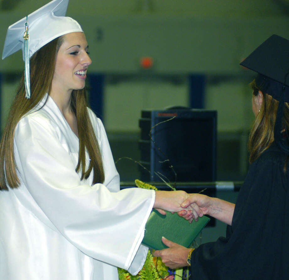Meeghan Doris receives her diploma from Board of Education chairwoman Wendy Faulenbach during New Milford High School's commencement exercises at the O'Neill Center on the campus of Western Connecticut State University in Danbury. June 22, 2013 Photo: Norm Cummings