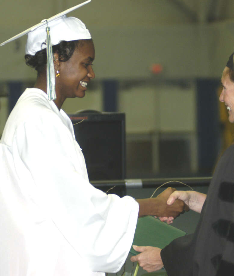 Eden Edwards-Harris receives her diploma from Board of Education chairwoman Wendy Faulenbach during New Milford High School's commencement exercises at the O'Neill Center on the campus of Western Connecticut State University in Danbury. June 22, 2013 Photo: Norm Cummings