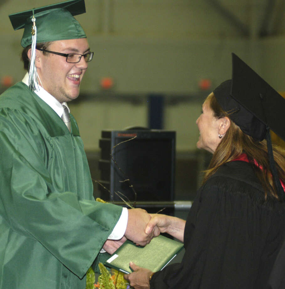 Justin Emmans receives his diploma from Board of Education chairwoman Wendy Faulenbach during New Milford High School's commencement exercises at the O'Neill Center on the campus of Western Connecticut State University in Danbury. June 22, 2013 Photo: Norm Cummings