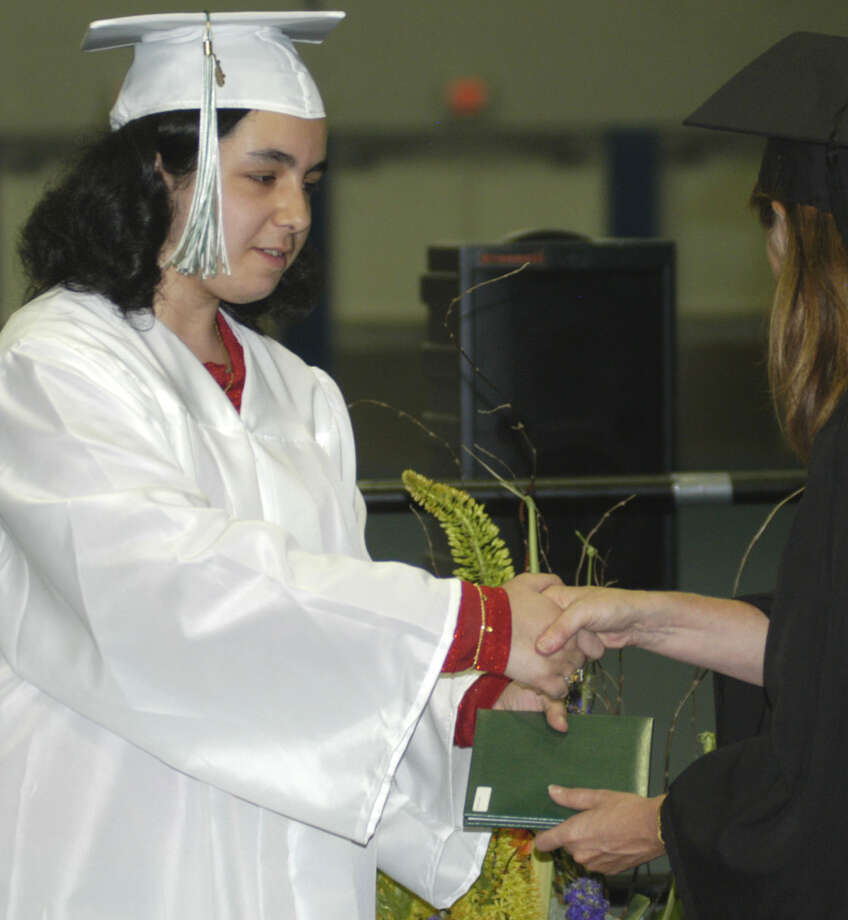 Layla Faridani receives her diploma from Board of Education chairwoman Wendy Faulenbach during New Milford High School's commencement exercises at the O'Neill Center on the campus of Western Connecticut State University in Danbury. June 22, 2013 Photo: Norm Cummings