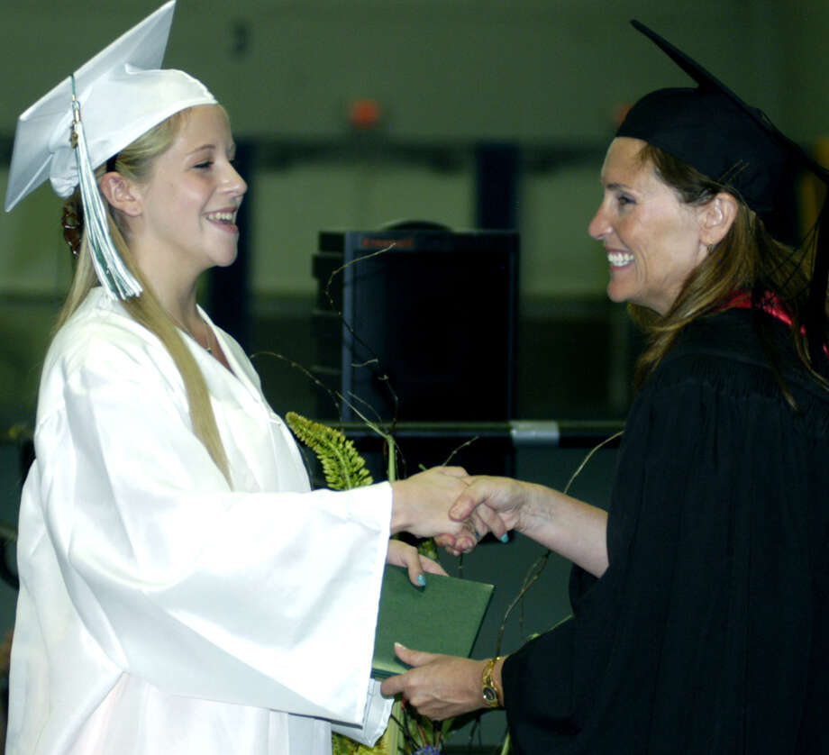 Lisa Fredlund receives her diploma from Board of Education chairwoman Wendy Faulenbach during New Milford High School's commencement exercises at the O'Neill Center on the campus of Western Connecticut State University in Danbury. June 22, 2013 Photo: Norm Cummings