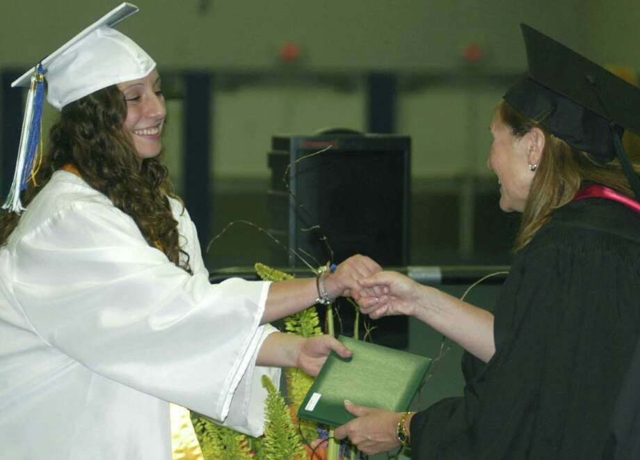 Julianna Fusco receives her diploma from Board of Education chairwoman Wendy Faulenbach during New Milford High School's commencement exercises at the O'Neill Center on the campus of Western Connecticut State University in Danbury. June 22, 2013 Photo: Norm Cummings