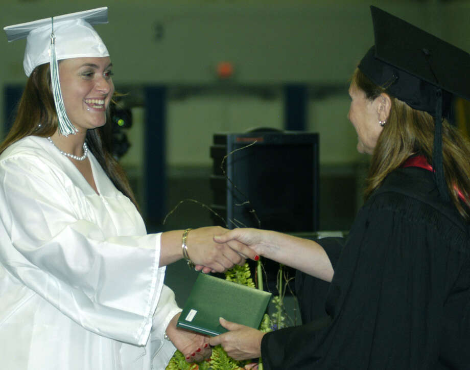 Mackenzie Gallagher receives her diploma from Board of Education chairwoman Wendy Faulenbach during New Milford High School's commencement exercises at the O'Neill Center on the campus of Western Connecticut State University in Danbury. June 22, 2013 Photo: Norm Cummings