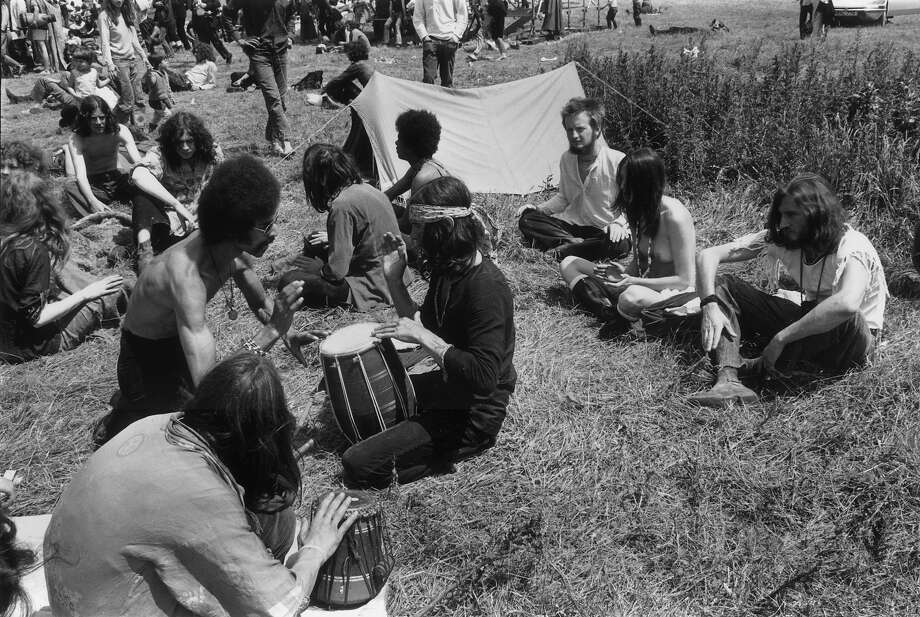 1971: Hippies at the second Glastonbury Festival celebrate the summer solstice with music. Photo: Ian Tyas, Getty Images / Hulton Archive