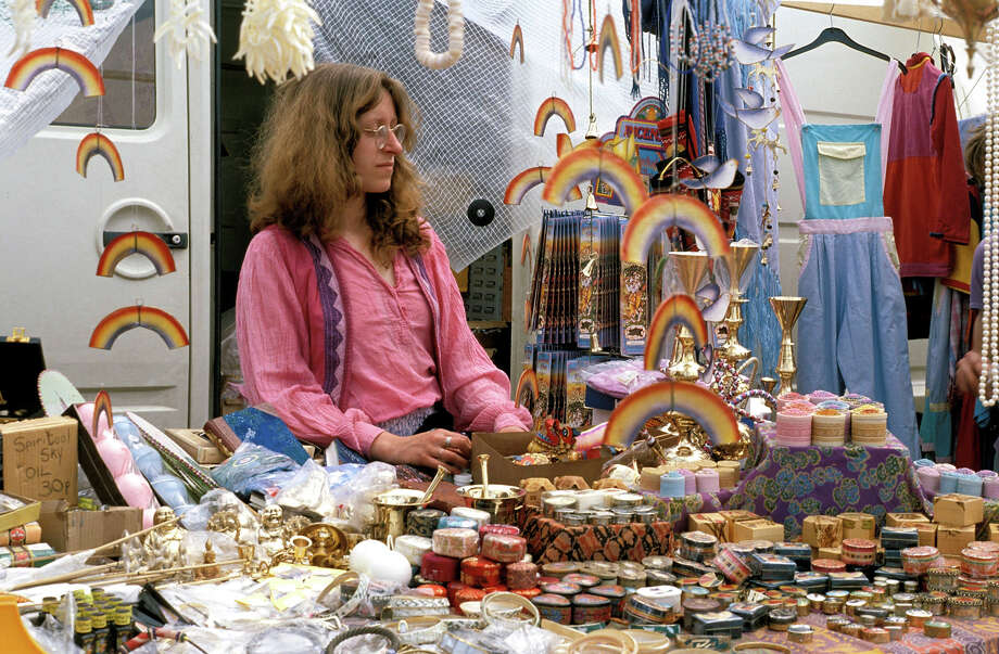 1983: A merchandise stall at the Glastonbury Festival. Photo: Pete Cronin, Redferns / Redferns