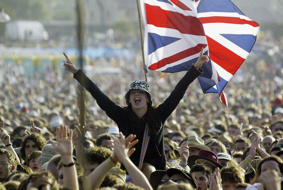2004: A fan cheers the band Franz Ferdinand during the 2004 Glastonbury Festival, on June 25, 2004 at Worthy Farm, Pilton, Somerset, England. Photo: Matt Cardy, Getty Images / 2004 Getty Images