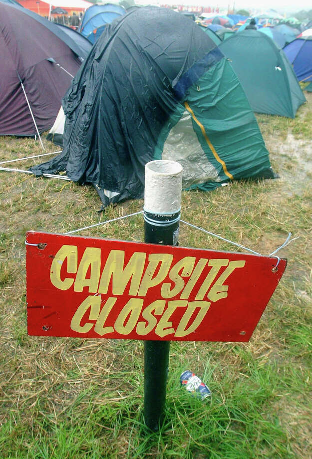2005: A sign in a campsite on the first day of the Glastonbury Music Festival 2005 at Worthy Farm, Pilton on June 24, 2005 in Somerset, England. Photo: Matt Cardy, Getty Images / 2005 Getty Images