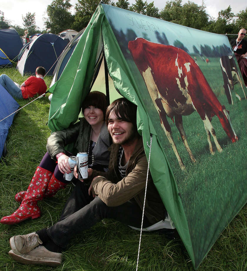 2007: Clare Murray and Adam Wearmouth from Newcastle sit in their tent at Worthy Farm, Pilton near Glastonbury, on June 20 2007 in Somerset, England. Photo: Matt Cardy, Getty Images / 2007 Getty Images