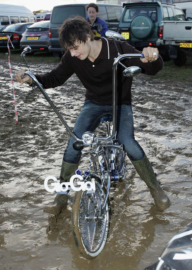 2007: Pete Doherty rides one of the bikes left for him and Kate Moss at Worthy Farm, Pilton near Glastonbury, on June 22 2007 in Somerset, England. The festival, that was started by dairy farmer Michael Eavis in 1970, has grown into the largest music festival in Europe. Photo: Matt Cardy, Getty Images / 2007 Getty Images
