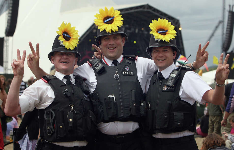 2008: Police officers (L-R) PC Sean Skelhorn, PC Nick Hoon and Sgt Craig Osborne stand in front of the Pyramid Stage at the Glastonbury Festival at Worthy Farm, Pilton on June 29 2008 in Glastonbury, Somerset, England. Photo: Matt Cardy, Getty Images / 2008 Getty Images