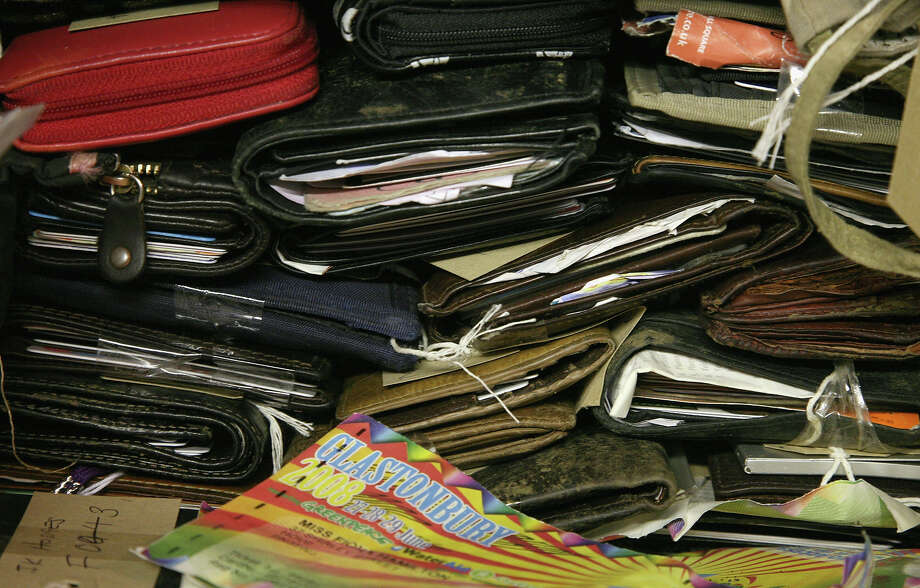 2008: Wallets and purses handed into the Lost And Found (LAF) office are stacked at the Glastonbury Festival Welfare Centre at Worthy Farm on July 1, 2008 in Glastonbury, Somerset, England. The office dealt with over 2,000 items during the festival which included approximately 400 mobile phones, 100 cameras and 400 wallets as well as passports, airline tickets, car keys as well as tents, wellies and rucksacks. Items brought to the office in previous festivals have included prosthetic legs, a piano, wetsuits, a barrister's wig and a substantial sum of cash handed in by a naked man. The office aims to have up to a third of items returned to their rightful owners and employs a team for six weeks after the festival closes to do so. Any items not claimed or identified are either recycled or given to charity. Photo: Matt Cardy, Getty Images / 2008 Getty Images