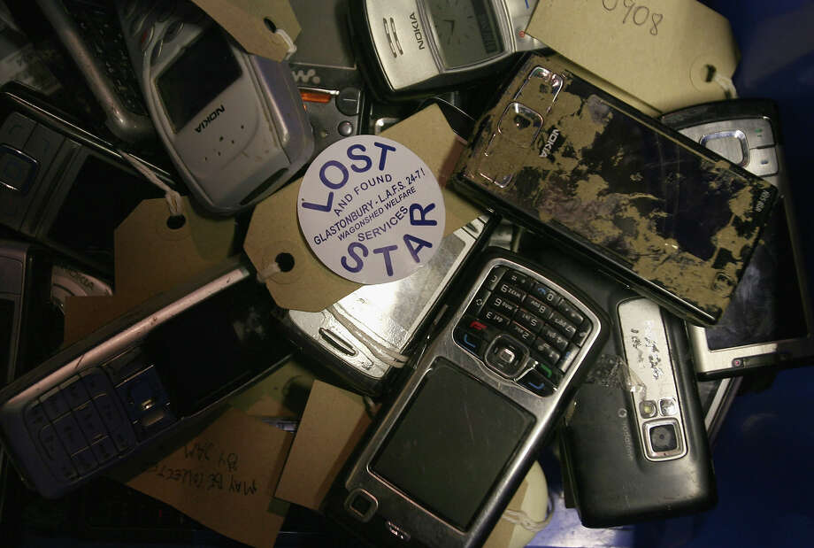 2008: Mobile phones handed into the Lost And Found Services (LAFS) office are sorted into containers at the Glastonbury Festival Welfare Centre, Worthy Farm on July 1, 2008 in Glastonbury, Somerset, England. The office dealt with over 2,000 items during the festival which included approximately 400 mobile phones, 100 cameras and 400 wallets as well as passports, airline tickets, car keys as well as tents, wellies and rucksacks. Items brought to the office in previous festivals have included prosthetic legs, a piano, wetsuits, a barrister's wig and a substantial sum of cash handed in by a naked man. The office aims to have up to a third of items returned to their rightful owners and employs a team for six weeks after the festival closes to do so. Any items not claimed or identified are either recycled or given to charity. Photo: Matt Cardy, Getty Images / 2008 Getty Images
