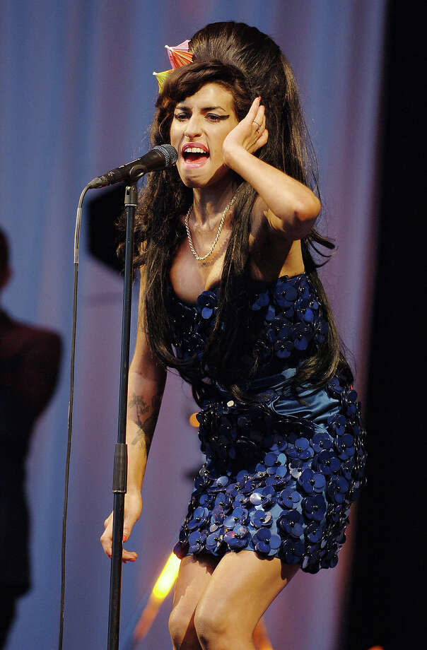 2008: Amy Winehouse performing on the Pyramid Stage. Photo: Tabatha Fireman, Redferns / Redferns