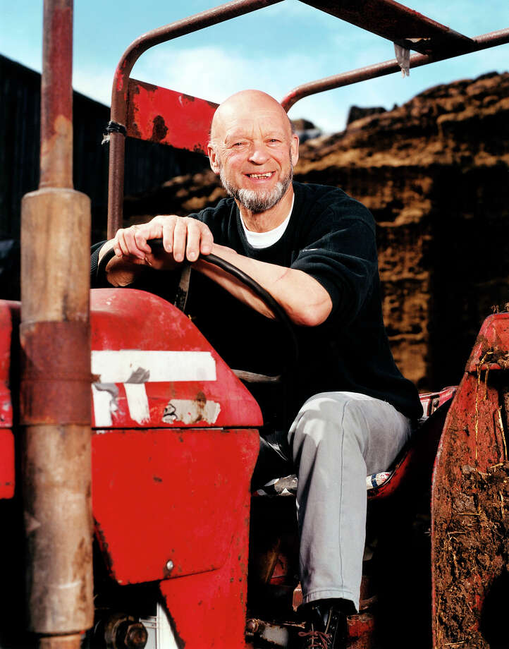 2002: Glastonbury organizer Michael Eavis on his farm, tractor. Photo: Mick Hutson, Redferns / Redferns