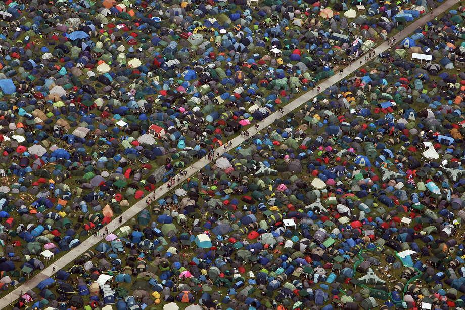 2009: Music fans move around the tents at the Glastonbury Festival site at Worthy Farm, Pilton on June 25, 2009 in Glastonbury, Somerset, England. Photo: Matt Cardy, Getty Images / 2009 Getty Images