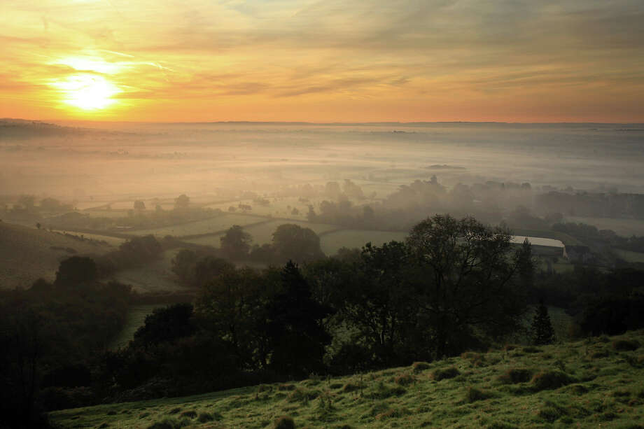 2009: The sun begins to rise over the Somerset Levels looking towards Pilton on October 13, 2009 near Glastonbury, England. Photo: Matt Cardy, Getty Images / 2009 Getty Images