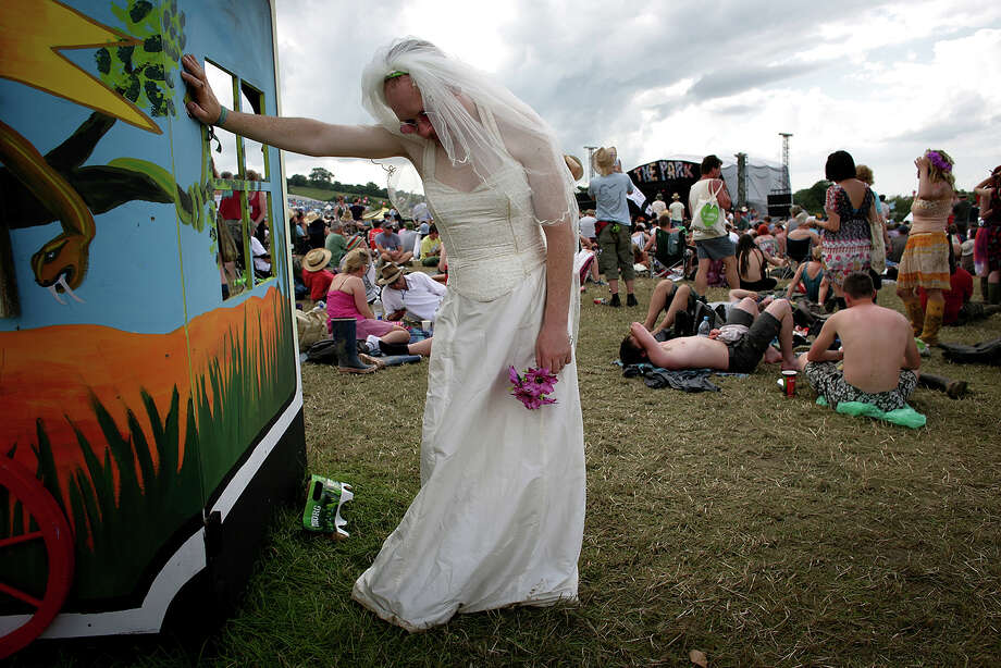 2009: A man dressed as a bride, exhausted, in the Park Area at Glastonbury, 27th June 2009. Photo: Martin Godwin, Getty Images / 2010 Getty Images