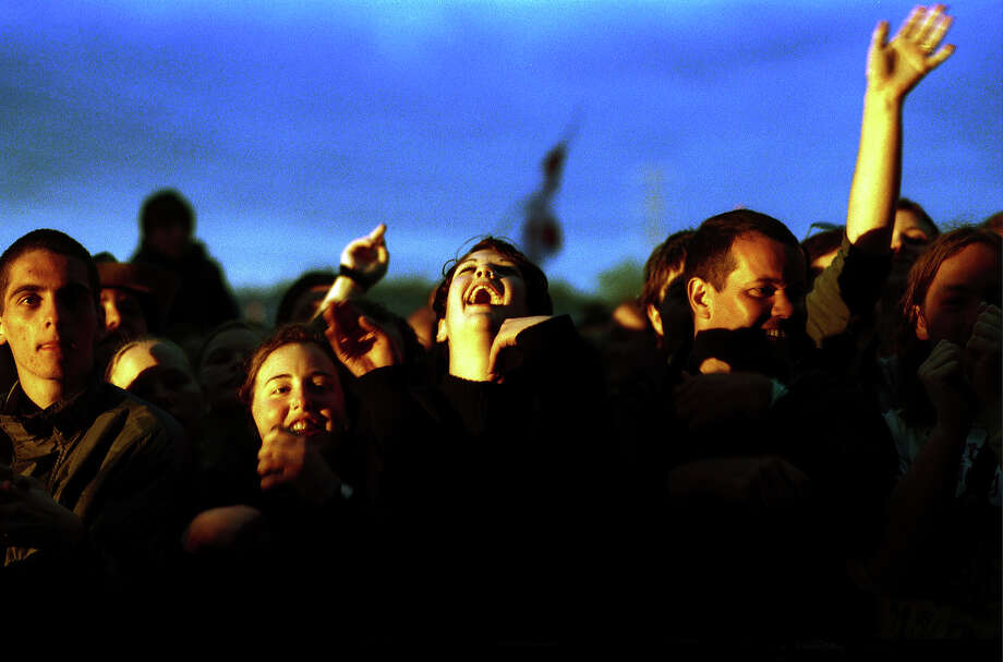 2000: Sun catching the crowds in front of the Pyramid Stage at Glastonbury, June 2000. Photo: Martin Godwin, Getty Images / 2010 Getty Images