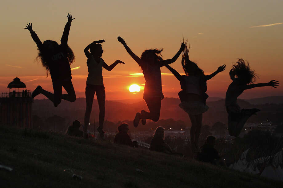 2010: People enjoy the sunset at the Glastonbury Festival site at Worthy Farm, Pilton on June 24, 2010 in Glastonbury, England. Photo: Matt Cardy, Getty Images / 2010 Getty Images