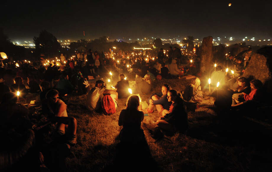 2010: Festival goers head up to the stone circle to wait for the sun rise on the final day of Glastonbury Festival at Worthy Farm on June 27, 2010 in Glastonbury, England. Photo: Tabatha Fireman, Redferns / 2010 Tabatha Fireman