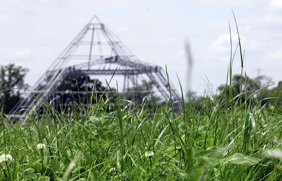 2012: Plants grow in a field of uncut grass in front of the skeleton of the main Pyramid Stage at the Glastonbury Festival site at Worthy Farm, Pilton on June 20, 2012 near Glastonbury, England. Photo: Matt Cardy, Getty Images / 2012 Getty Images