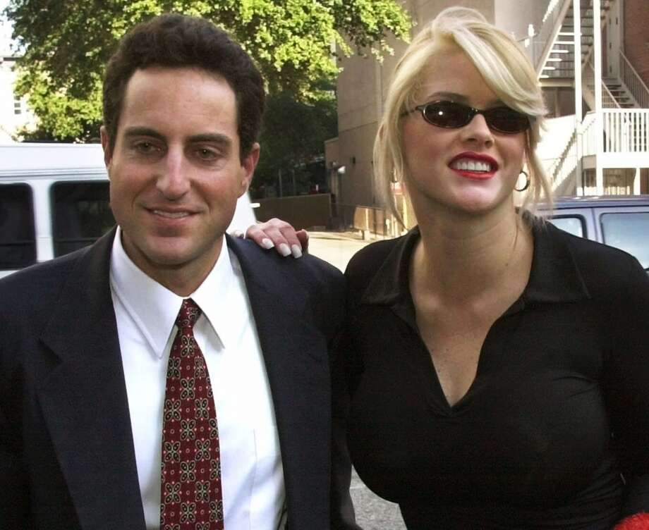 In this Oct. 2, 2000 file photo, Anna Nicole Smith, right,  smiles as she walks to the courthouse with her attorney Howard K. Stern in Houston. Attorneys in the Anna Nicole Smith drug conspiracy trial are set with final arguments aimed at swaying jurors in reaching a complicated and crucial set of verdicts that will affect two doctors and the deceased model's former boyfriend