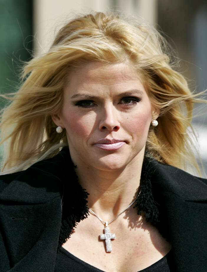 In this Feb. 28, 2006 file photo, Anna Nicole Smith, leaves the U.S. Supreme Court in Washington.