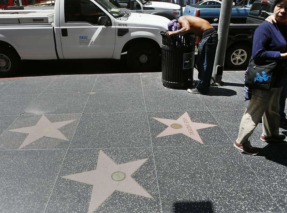 """Hollywood, Calif.""""You go expecting lights, camera, acton! What you really get is bums, hookers and garbage."""" — ohsureyoudo""""I see people kneeling, sitting, touching the stars on the Walk of Fame all the time. Little do they realize that a homeless person peed on it last night. And every night. Also, Hollywood Blvd is 90% smoke shops and stripper stores."""" — bewilderedhill Photo: Damian Dovarganes, Associated Press"""